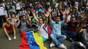 Anti-government demonstrator's chant slogans against the government during a protest in Caracas, Venezuela, Thursday, Feb. 12, 2015.